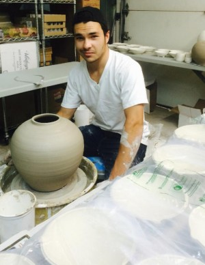 Johnny making pots