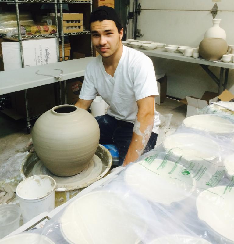 Johnny making pots